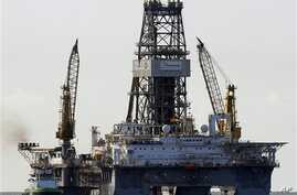 The Transocean Development Driller III is seen on the surface above the Deepwater Horizon oil wellhead on the Gulf of Mexico near the coast of Louisiana, 16 Jul 2010