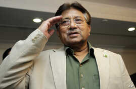Former Pakistani President Pervez Musharraf salutes his party members during a ceremony to celebrate Pakistan National Day ahead his trip to Karachi, in Dubai, United Arab Emirates, Saturday, March 23, 2013. Musharraf says he will follow through with