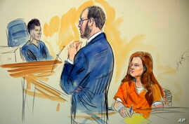 This courtroom sketch depicts Maria Butina, a 29-year-old gun-rights activist suspected of being a covert Russian agent, listening to Assistant U.S. Attorney Erik Kenerson as he speaks to Judge Deborah Robinson, left, during a hearing in federal cour