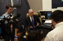 U.S. Secretary of Defense James N. Mattis speaks to reporters aboard a military aircraft en route to New Delhi, India, Sept. 4, 2018.