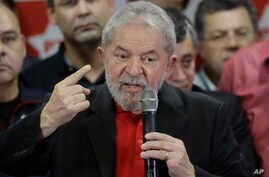 Former Brazilian President Luiz Inacio Lula da Silva delivers a brief speech to the media and supporters at the headquarters of the Worker's Party in Sao Paulo, Brazil, Thursday, July 13, 2017.