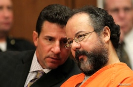 Ariel Castro (R), 53, listens to his attorney Craig Weintraub during Castro's sentencing on kidnapping, rape and murder in Cleveland, Ohio, August 1, 2013.