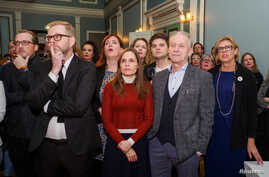The Independence Party members and supporters react as they watch the first results of the snap parliamentary election in Reykjavik, Iceland, Oct. 28, 2017. The party won 26 percent of the vote, down 3 percentage points from last year.
