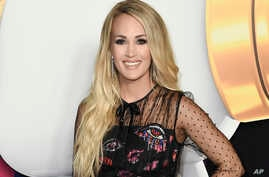 FILE - Carrie Underwood attends the 2018 Radio Disney Music Awards in Los Angeles, June 22, 2018.