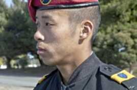 The changing face of the enemy makes a military career more acceptable to some Asian-Americans.