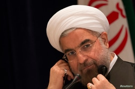 FILE - Iran's President Hassan Rouhani takes questions from journalists during a news conference in New York, Sept. 27, 2013.