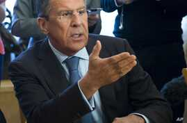 Russian Foreign Minister Sergey Lavrov, gestures while speaking to Organization for Security and Cooperation in Europe (OSCE) Secretary General Lamberto Zannier during their talks  in Moscow, Russia, Wednesday, June 11, 2014