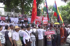 """Demonstrators, including Buddhist monks protest out the U.S. Embassy in Yangon, Myanmar, April 28, 2016, against the embassy use of the term """"Rohingya."""""""