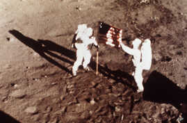 "** FILE ** In this July 20, 1969 file photo, Apollo 11 astronauts Neil Armstrong and Edwin E. ""Buzz"" Aldrin, the first men to land on the moon, plant the U.S. flag on the lunar surface. (NASA)"