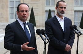 French President Francois Hollande, left, and head of the new Syrian National Coalition for Opposition and Revolutionary Forces Mouaz al-Khatib, right, when  France recognized the rebel opposition in Paris, Nov. 17. (AP)