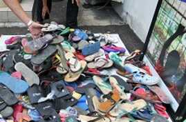 Indonesians Use Sandals as Justice Symbol