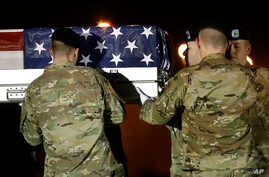 FILE - A U.S. Army carry team loads a transfer case containing the remains of Capt. Andrew P. Ross into a vehicle, Nov. 30, 2018, at Dover Air Force Base, Del.