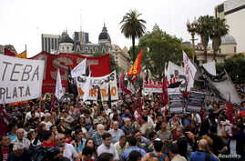 Demonstrators gather during a protest against economic policies implemented by Argentina's President Mauricio Macri in Buenos Aires, Argentina, Dec. 22, 2015.