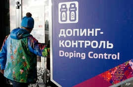 "A man walks past a sign reading ""Doping Control"" in Russian at a 2014 Sochi Winter Olympics site in Krasnaya Polyana, Russia. Feb. 21, 2014. Moscow has been under fire for months over allegations of state-run doping."