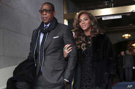 Recording artists Jay-Z and Beyonce arrive on the West Front of the Capitol in Washington, Jan. 21, 2013, for the Presidential Barack Obama's ceremonial swearing-in ceremony during the 57th Presidential Inauguration.