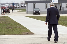Secretary of State John Kerry walks from his plane after arriving in Chicago, April 15, 2013, to visit the parents Anne Smedinghoff,  the young U.S. diplomat killed in Afghanistan while delivering textbooks.
