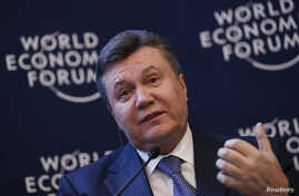 Ukraine's President Viktor Yanukovich addresses delegates during the annual meeting of World Economic Forum in Davos, Switzerland, Jan. 24, 2013.