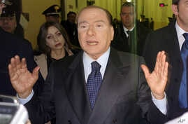 Former Italian Premier Silvio Berlusconi speaks to reporters after a hearing in his Mediaset appeals trial, at Milan's court, Italy, Mar. 1, 2013.