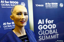 """Sophia, a robot integrating the latest technologies and artificial intelligence developed by Hanson Robotics is pictured during a presentation at the """"AI for Good"""" Global Summit at the International Telecommunication Union (ITU) in Geneva, Switzerlan"""
