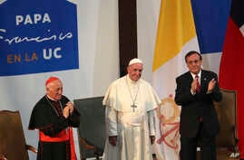 FILE - Pope Francis is pictured with Cardinal Ricardo Ezzati Andrello at the Pontifical Catholic University of Chile in Santiago, Jan.17, 2018.  Ezzati, toldreporters on July 12, 2018, following Oscar Munoz's arrest on sex abuse charges, that he fel