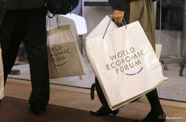 Attendees walk in the Congress Hall during the annual meeting of the World Economic Forum in Davos, Switzerland, Jan. 17, 2017.