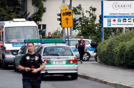 A police officer walks in front of the Benjamin-Franklin Hospital in the southwestern district of Steglitz in Berlin, Germany, July 26, 2016.