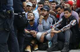 FILE - Migrants wait to cross the border from Austria near Freilassing, Germany, Sept. 17, 2015. The U.S. House of Representatives, which recently voted to suspend Syrian refugee resettlement, plans to take up a bill on visa waivers, an emerging risk