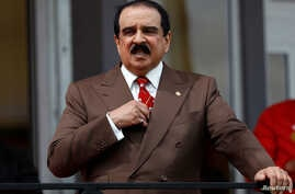 FILE - Bahrain's King Hamad bin Isa Al Khalifa is pictured in Windsor, England, May 11, 2018. In addition to the charges filed alleged militants on Sept. 25, 2018, Bahrain's Interior Ministry separately announced that police had arrested 15 people ov