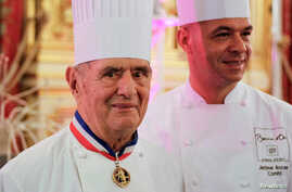 FILE - French chef Paul Bocuse, left, is pictured with his son Jerome at the town hall in Lyon, France, Jan. 25, 2011.