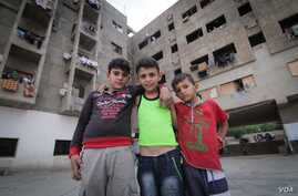 Syrian youngsters pose in front of the Ouzai building. With some families here for more than three years, many have grown up here. (Photo - J. Owens/VOA)