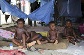 Children sit in a tent at a relief center for flood victims in Patani, Delta state, Oct. 13, 2012.