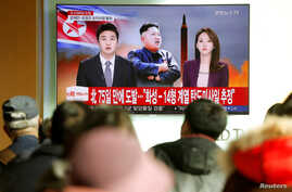 People watch a TV broadcasting a news report on North Korea firing what appeared to be an intercontinental ballistic missile (ICBM) that landed close to Japan, in Seoul, South Korea, Nov. 29, 2017.