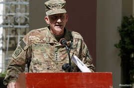 FILE - U.S. Army General John Nicholson, Commander of Resolute Support forces and U.S. forces in Afghanistan, speaks during a memorial ceremony to commemorate the 15th anniversary of the 9/11 attacks, in Kabul, Afghanistan.