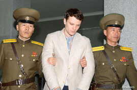FILE - Otto Frederick Warmbier, a University of Virginia student, has been detained in North Korea since early January, is taken to North Korea's top court in Pyongyang, North Korea, March 16, 2016.