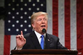 President Donald Trump delivers his first State of the Union address in the House chamber of the U.S. Capitol to a joint session of Congress, Jan. 30, 2018 in Washington.