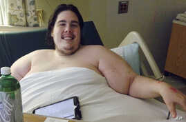 Steven Assanti, 33, rests in bed at a Rhode Island hospital. Assanti, who weighs nearly 800 pounds, said he was kicked out of another hospital for ordering pizza.