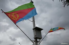 Ethiopian and Eritrean flags flutter during the welcoming ceremony of Eritrean Foreign Minister Osman Saleh and his delegation at the Bole International Airport in Addis Ababa, Ethiopia, June 26, 2018.