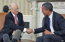 President Barack Obama meets with Prime Minister Beji Caid Essebsi of Tunisia in the Oval Office at the White House in Washington, October 7, 2011.