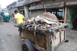 A worker pulls a cart of animal hides. Human Rights Watch has warned of toxic conditions for workers and Hazaribagh's residents. (A. Yee/VOA)