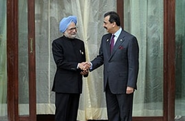 Indian Prime Minister Manmohan Singh (L) and his Pakistani counterpart Syed Yousuf Raza Gilani shake hands prior to bilateral talks on the sidelines of the eight-nation South Asian Association for Regional Co-operation (SAARC) summit in Thimphu, Bhut