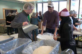 George Mason University students participate in Love Week, packaging 40,000 meals for refugees.