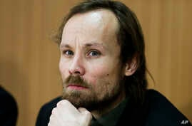 FILE - German freelance reporter Billy Six attends a news conference in Berlin, March 6, 2013. The freelance journalist had been released from 12-weeks captivity in Syria and said he was not mistreated by his captors.