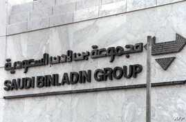 FILE - The logo of of the Saudi Binladin Group is seen at the company's headquarters in Jeddah, Saudi Arabia, Sept. 20, 2001.