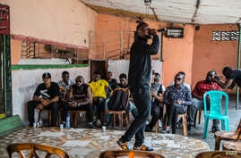 Rap music artists gather for a meeting to discuss how to get involved in politics in Kinshasa, Democratic Republic of Congo.