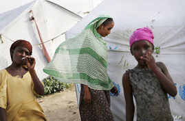 FILE - Refugees from the Central African Republic are seen at Zafaye camp, some 15 kilometers (10 miles) outside N'Djamena, Chad, March 11, 2015.