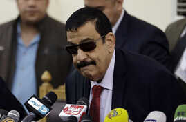 Egyptian Judge Mohammed Nagi Shehata arrives to a courtroom to read the verdicts in a case rooted in violence that swept the country after the military-led ouster of Islamist President Mohammed Morsi in 2013, in Cairo, Egypt, Saturday, April 11, 2015