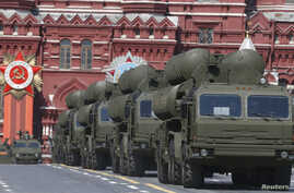 FILE - Russian S-400 surface-to-air missile systems are seen on display during a parade at Red Square in Moscow, Russia, May 9, 2015.