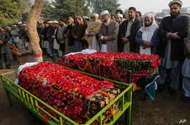 Siraj-ul-Haq, fourth right, chief of Pakistan's religious party Jammat-e-Islami, leads a funeral prayer for a student killed in Tuesday's Taliban attack on a school in Peshawar, Pakistan, Dec. 17, 2014.