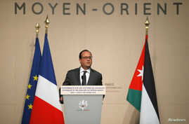 French President Francois Hollande delivers a speech at the opening of a one-day UN conference to find ways to help minorities in the Middle East persecuted by Islamic State militants, in Paris, Sept. 8, 2015.