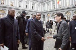 Congo President Denis Sassou Nguesso, center, arrives for a conference on Ebola at the Egmont Palace in Brussels, March 3, 2015.